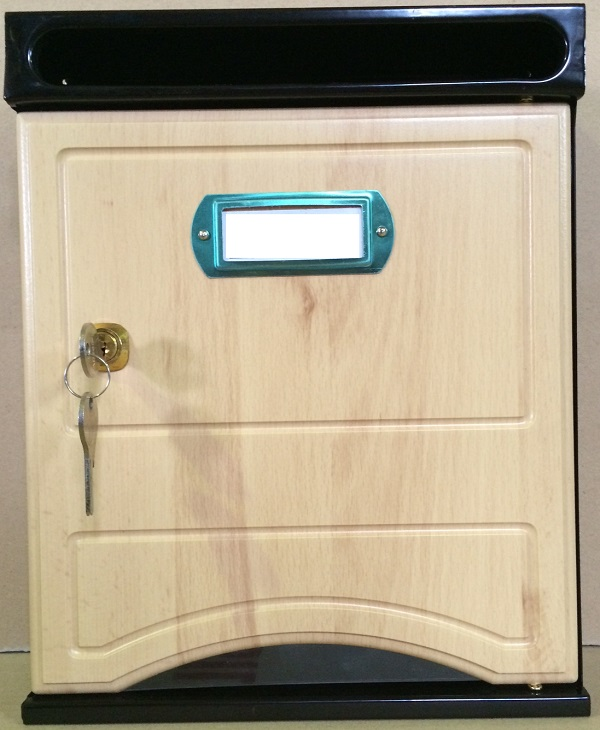 Buzón Arfe Modelo 1020-8 con cuerpo de acero negro y puerta melamina de HAYA. Antivandalico: boca separada de la puerta de buzón. Apertura lateral