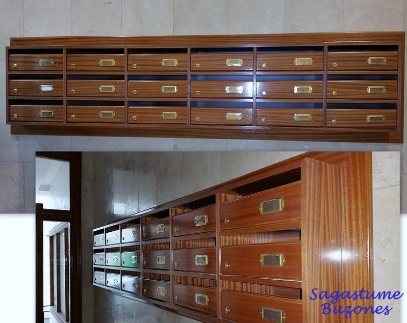 Agrupación de buzones Deval instalados en Santander. Fabricados a medida de madera de sapelly. Tamaño revistero.
